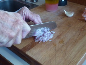 Mincing garlic.