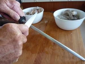 Using a knife steel.