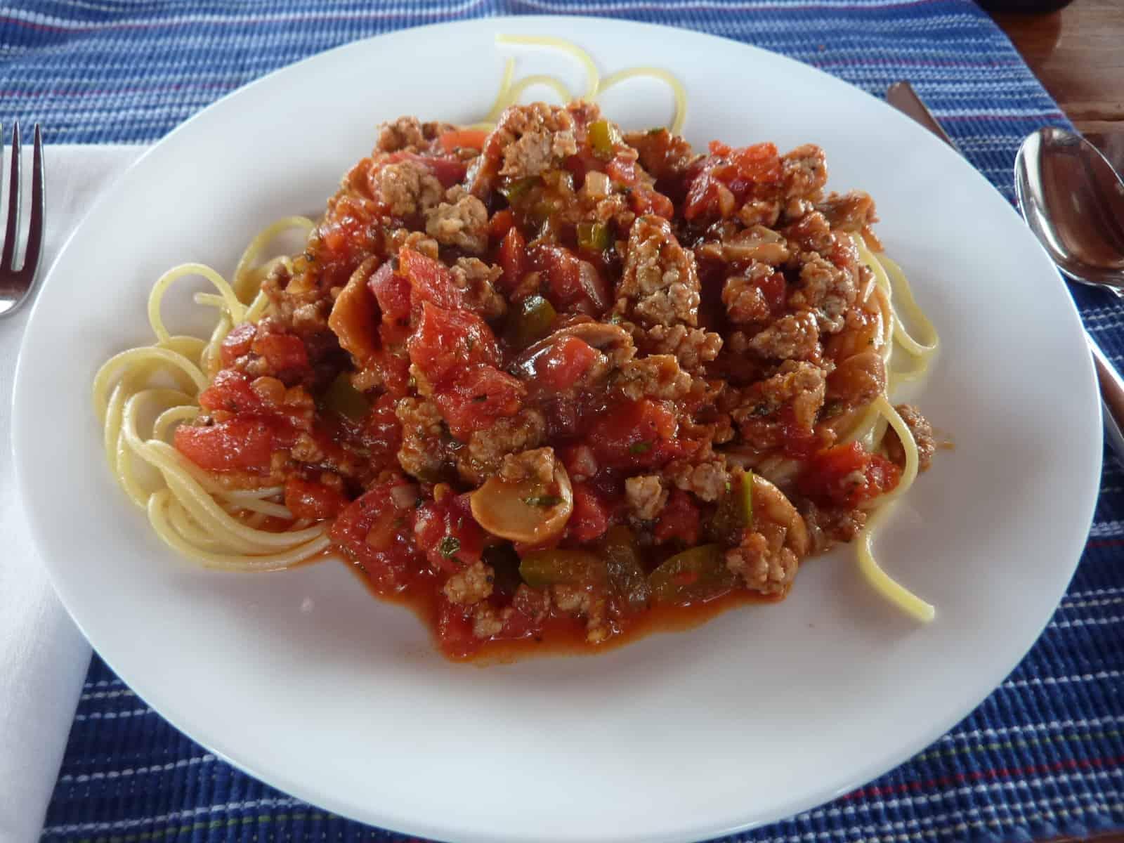 Plate of spaghetti with marinara sauce and sausage.