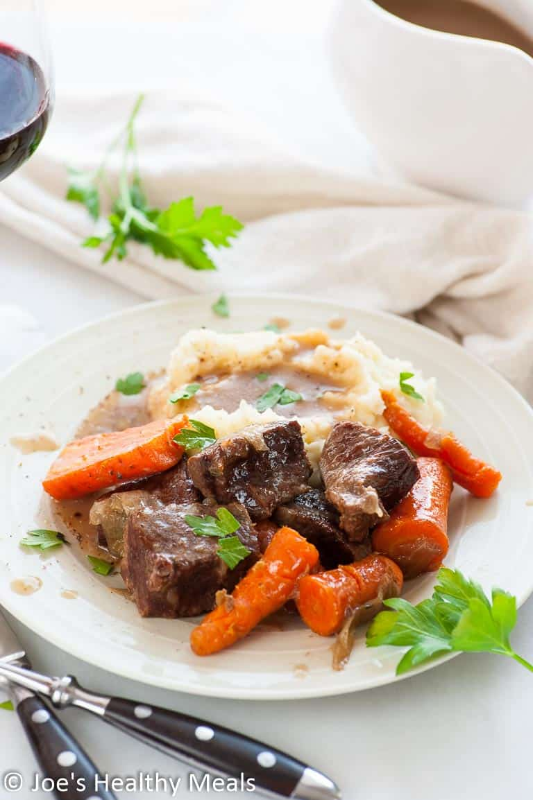 Braised short ribs slow cooked in Guinness stout until the meat is super tender and flavorful. | joeshealthymeals.com