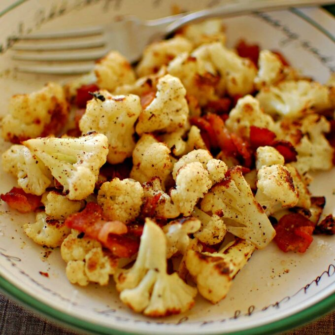 Pan seared cauliflower with bacon. Wonderful side dish to have with chicken or a small steak. Enjoy! | joeshealthymeals.com