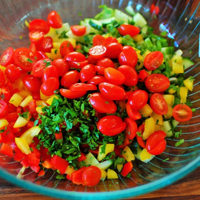 Chopped ingredients for Cold Pasta Salad. Delicious low calorie salad that is perfect for a crowd or summer potluck. | joeshealthymeals.com