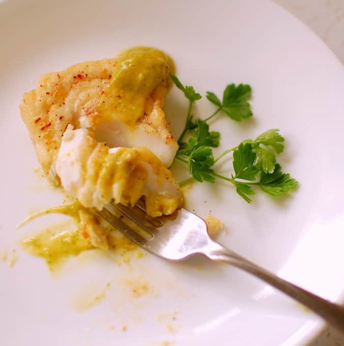 Creamy avocado sauce on haddock. This is an easy recipe, using fresh ingredients to make a wonderful tasting condiment to pair with fried fish. | joeshealthymeals.com
