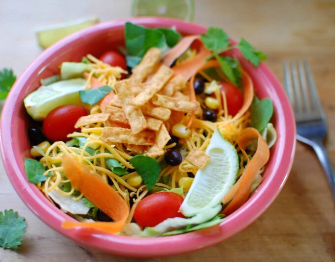 southwest salad in a pink bowl ready to eat