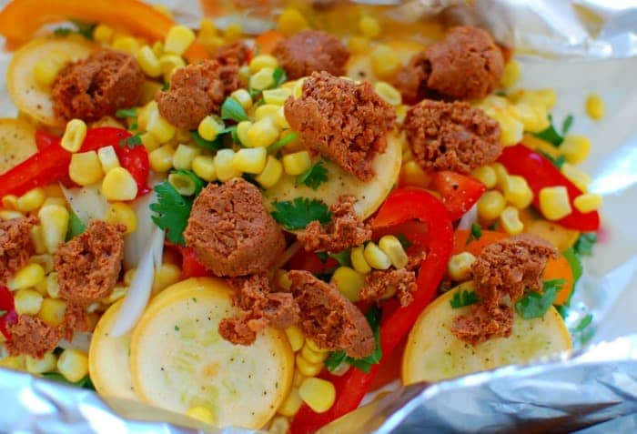 Grilled chorizo and vegetables in foil pack. Easy and delicious way to prepare an evening meal. This cooked perfectly and was soo good!