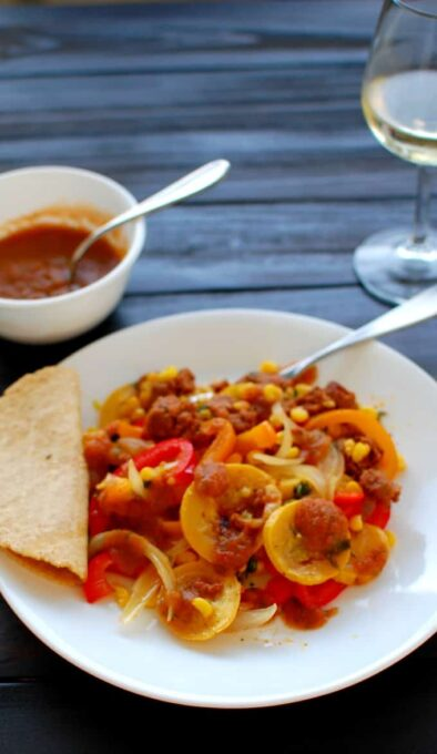 Grilled Chorizo and Vegetables Foil Pack. This is an easy and delicious meal, served with salsa roja on the side. This has tons of flavor!   joeshealthymeals.com