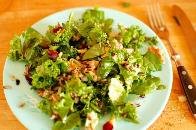 Kale and wild rice salad with pomegranate dressing. Hearty and healthy salad with a pomegranate molasses dressing. Mighty good tasting recipe.   joeshealthymeals.com