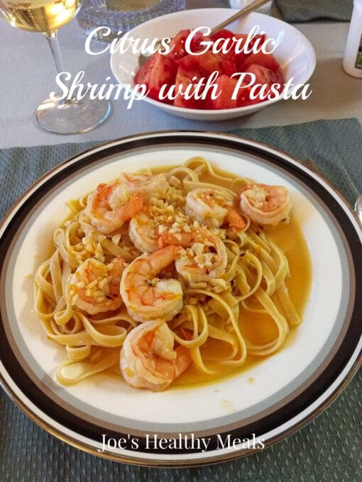Citrus garlic shrimp with pasta on a plate Pinterest pin.