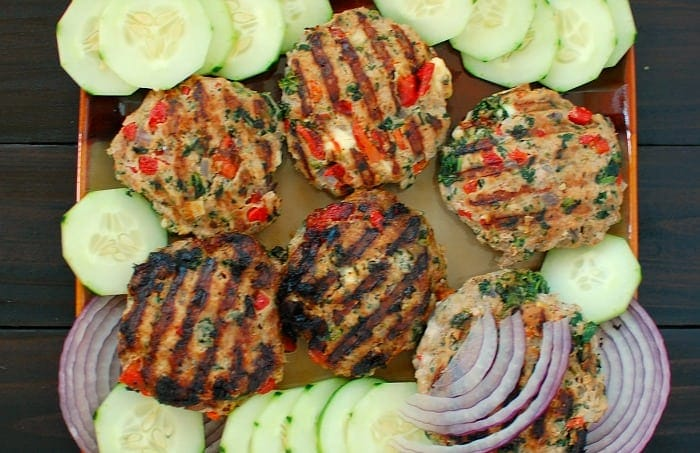 Overhead view of a platter of burgers.