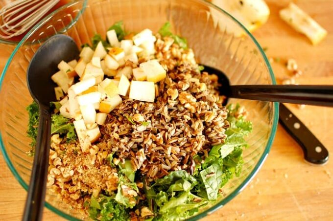 Kale and wild rice salad with pomegranate molasses dressing. Hearty and healthy salad with a slightly sweet pomegranate dressing. Add in some walnuts, asian pear and craisins for flavor. This is outstanding.   joeshealthymeals.com