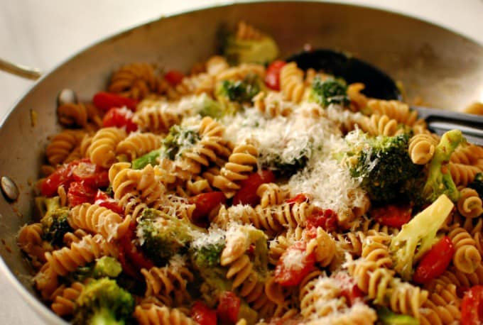 Whole wheat pasta with broccoli and grape tomatoes with grated parmesan.