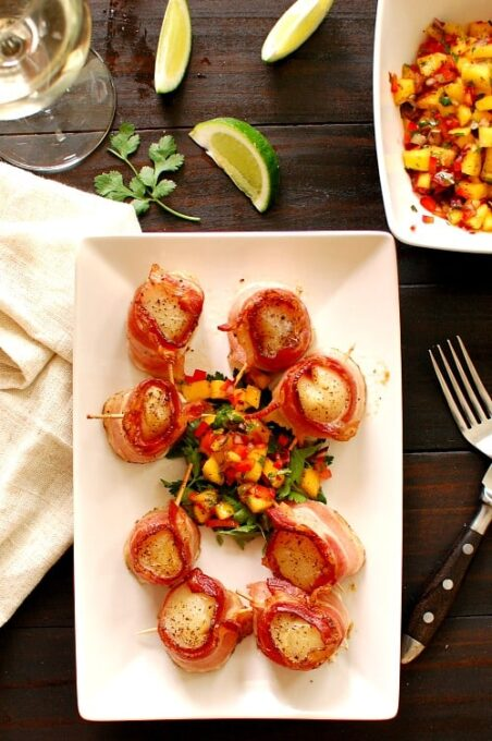 Scallops wrapped in bacon. Make a spicy mango salsa to go along with your scallops. This is a great appetizer recipe or also a main course.   joeshealthymeals.com