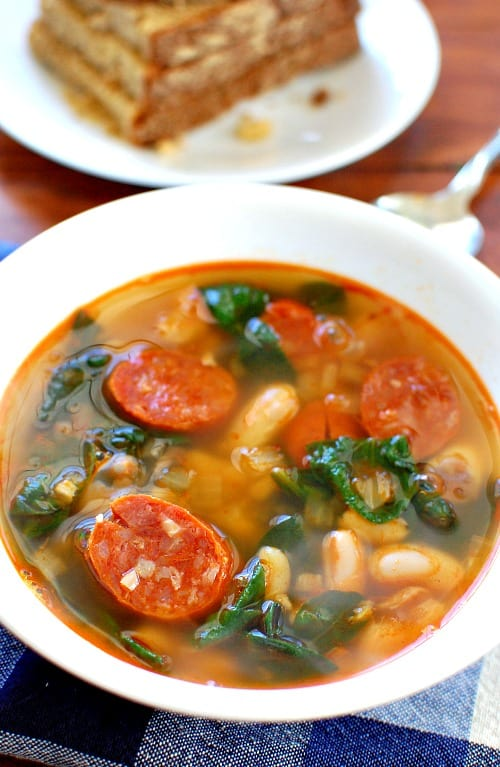 Chorizo white bean soup. This soup is full of flavor from the smokey paprika in the sausage. It is delicious with a good hearty bread.   joeshealthymeals.com