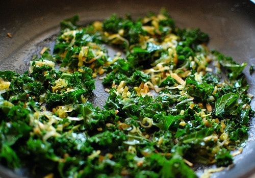 Kale and leeks being softened for Irish colcannon. Add to creamy mashed potatoes for a taste of Ireland. | joeshealthymeals.com