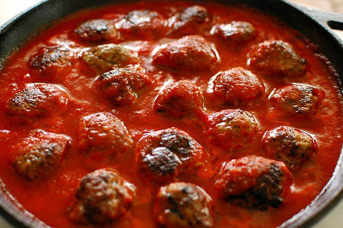 Meatballs in homemade marinara sauce. Top with grated parmesan cheese and brown under a broiler for a few minutes. Delicious!   joeshealthymeals.com
