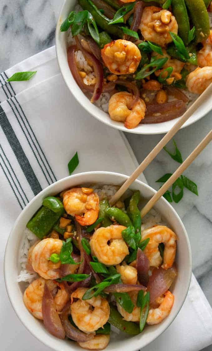 Overhead view of 2 bowls of shrimp stir fry.