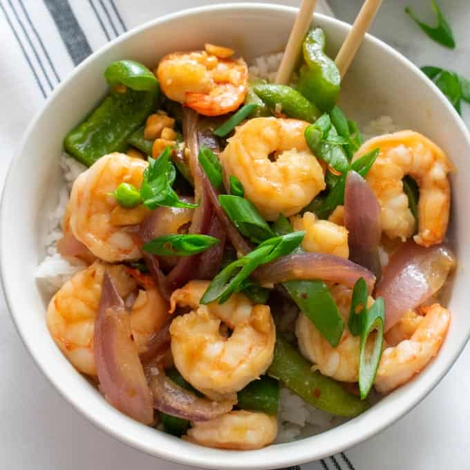 Overhead, close-up view of spicy shrimp stir fry.