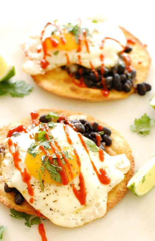 Black bean and egg tostada with sriracha. Kick up your breakfast, lunch, or dinner with this delicious tostada. | joeshealthymeals.com