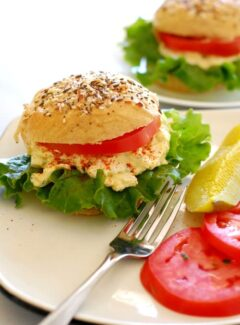 rye sandwich rolls with egg salad and tomatoes