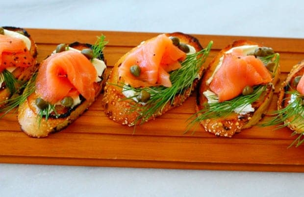 Salmon appetizer on a toasted baguette.
