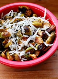 Spiced up roasted Brussels sprouts. Finished off with a little hot sauce, these are not your Mama's crumby Brussels sprouts! | joeshealthymeals.com