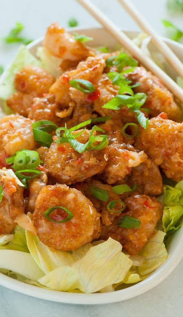 Bang bang shrimp with chopped green onion.