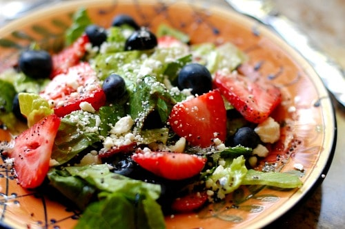 Strawberry salad with poppy seed dressing. Wonderfully refreshing summertime salad that everyone loves. | joeshealthymeals.com