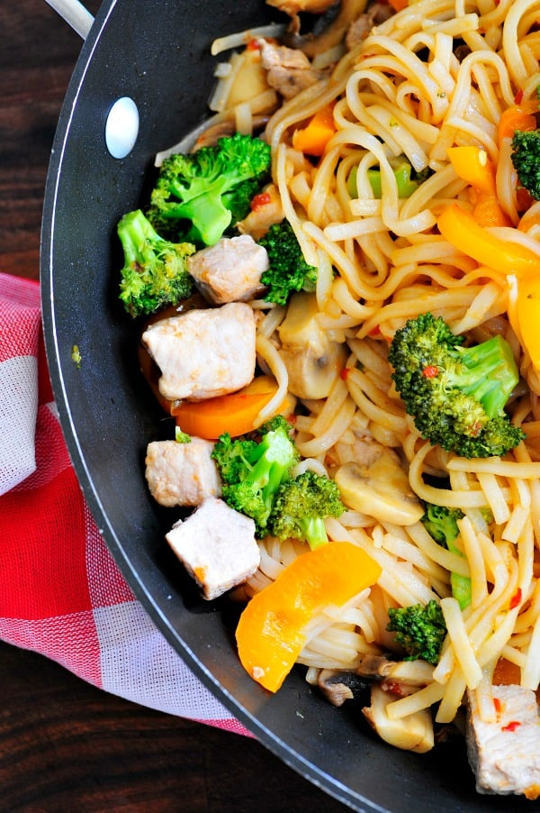 Stir fried pork with rice noodles. This recipe is a super combination of sweet and hot spices that really compliments the whole dish. | joeshealthymeals.com