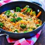 Skillet of pork, vegetables, and rice noodle stir fry.