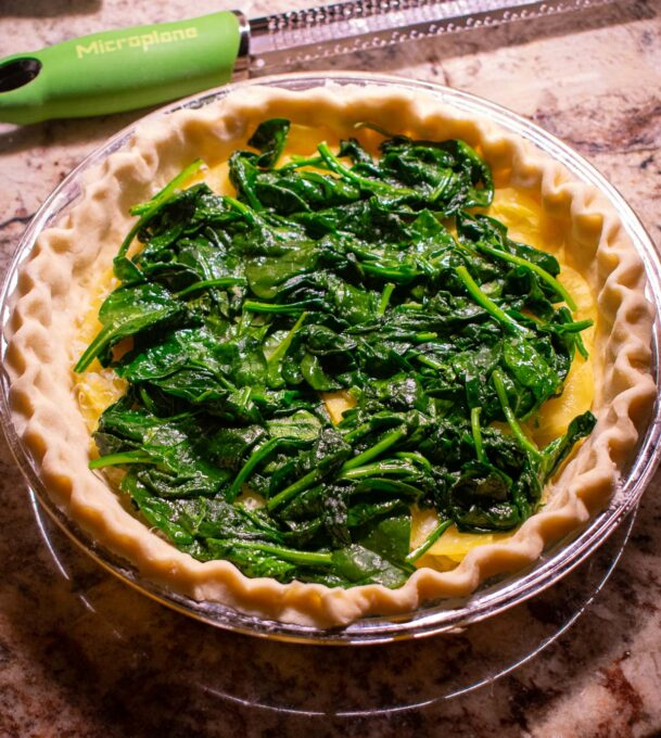 wilted spinach in a pie crust