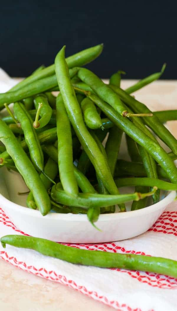 Green beans with mushrooms and bacon. Easy and delicious side dish with lots of bacony flavor and green bean freshness.   joeshealthymeals.com