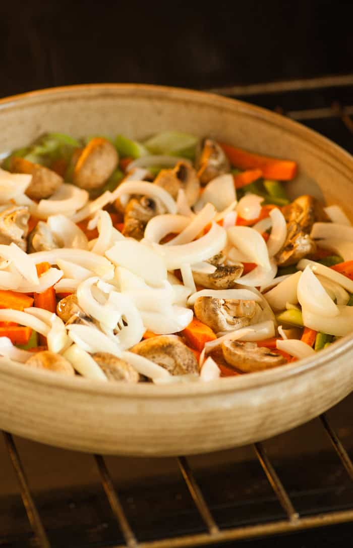 Uncooked vegetables in a casserole dish.