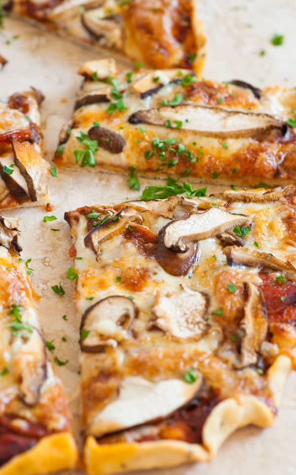 Side view of several pieces of pizza.