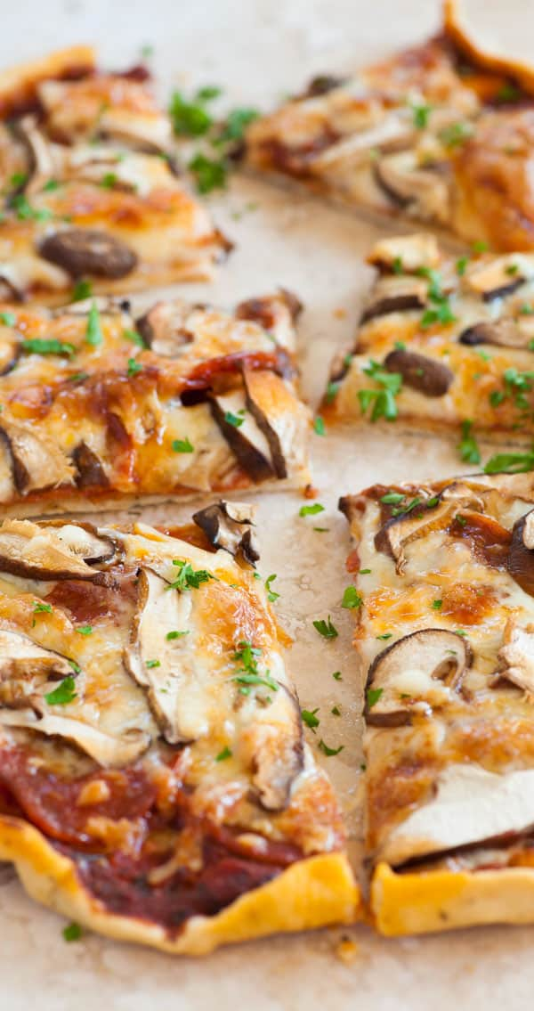 Side view of baked pizza.