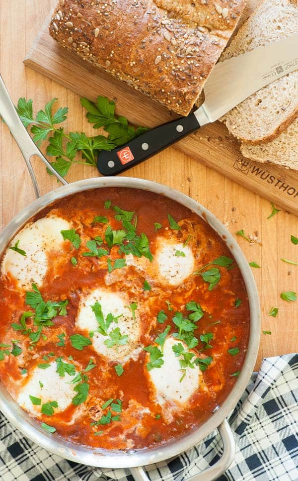 Shakshuka. African and Mid eastern poached eggs in spicy tomato sauce. A treat for breakfast, lunch, or dinner. | joeshealthymeals.com