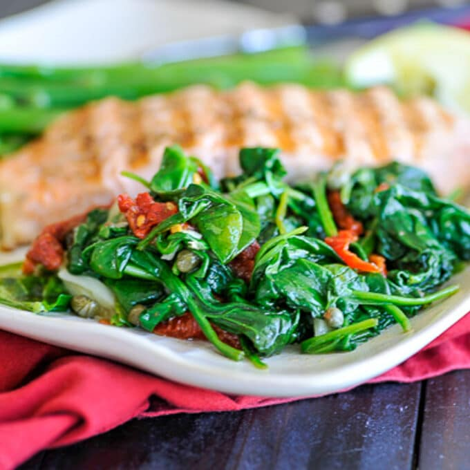 Close up of spinach and sun dried tomatoes.