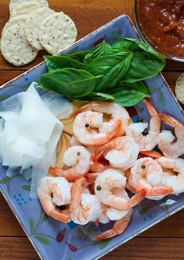 Overhead view of a plate of poached shrimp.
