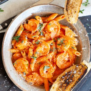 bowl of penne pasta and shrimp