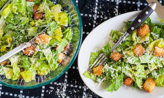 Traditional Caesar Dressing on a salad plate.