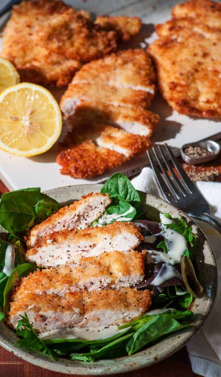 Breaded pan-fried crispy chicken cutlets. Surprisingly easy to make and perfect for a weeknight meal. | joeshealthymeals.com