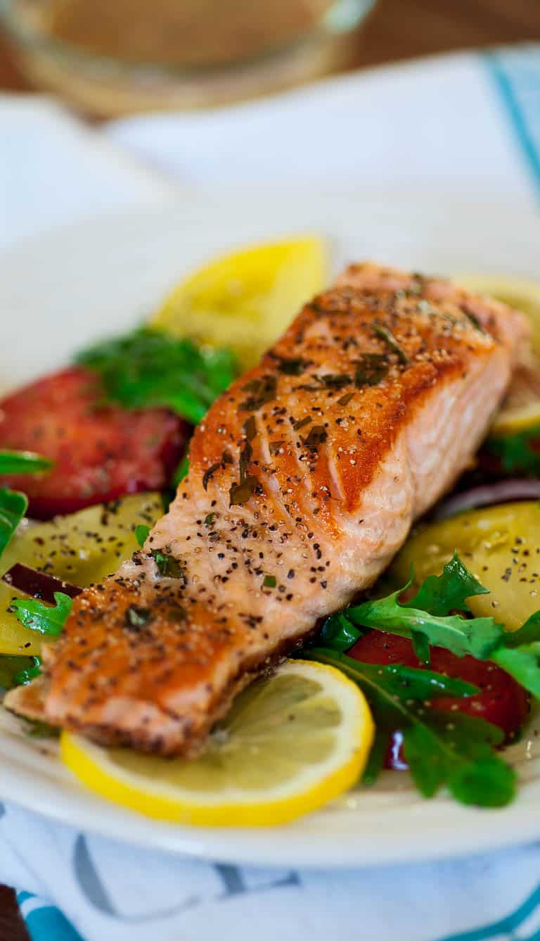 Pan-fried salmon steaks with arugula salad. Delicious easy meal with perfectly pan-fried salmon. | joeshealthymeals.com