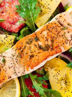 Pan-fried salmon with arugula salad.   joeshealthymeals.com