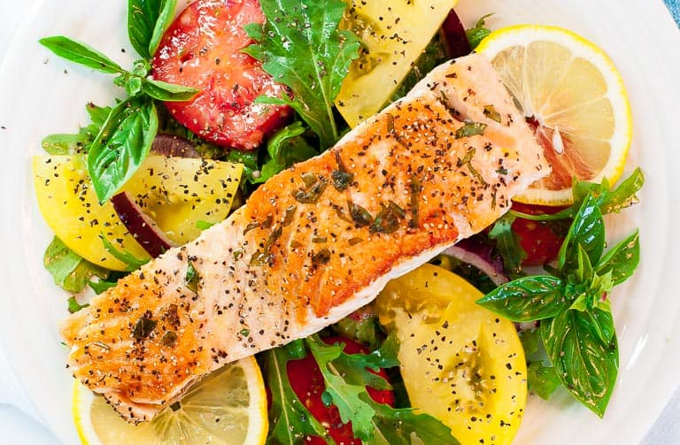 Pan-fried salmon with arugula salad. Delicious easy meal with perfectly pan-fried salmon.   joeshealthymeals.com