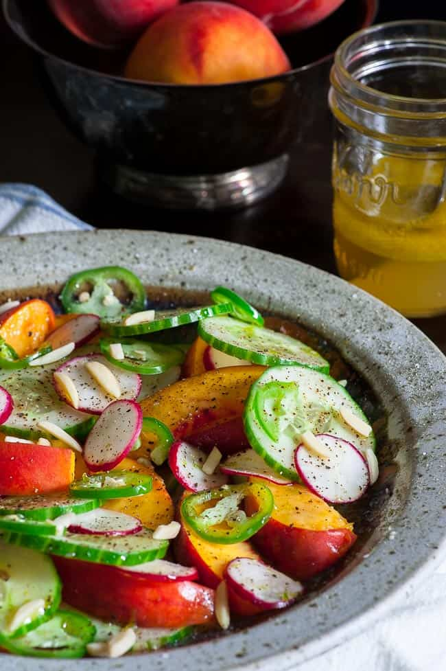 Peach cucumber salad and honey lime vinaigrette. Peach cucumber salad with honey lime vinaigrette is a perfect complement to anything that's barbecued or grilled. With peaches being plentiful right now, it's time to make this salad! | joeshealthymeals.com