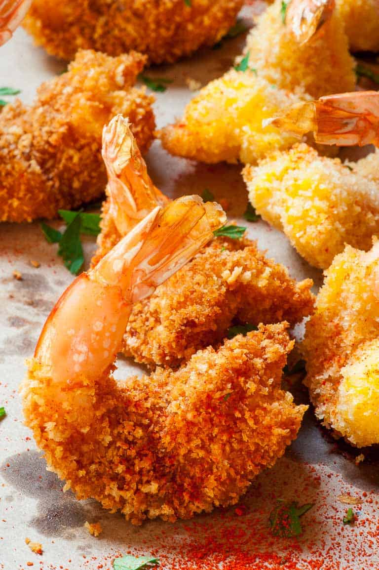 Breaded butterfly shrimp. Tasty and much less calories than deep fried. | joeshealthymeals.com