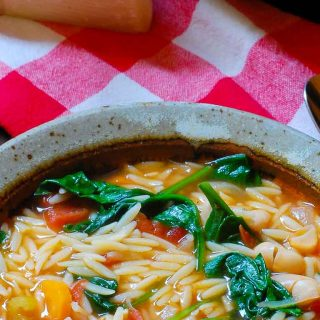 Close-up of a bowl of vegetable minestrone soup.