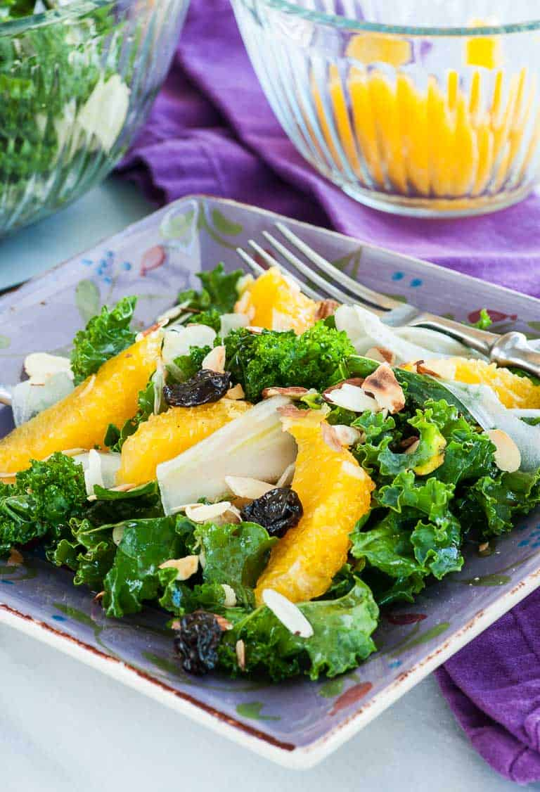 Kale and fennel salad with orange sections, dried cherries, and slivered almonds. Tossed with an orange and balsamic vinegar dressing.