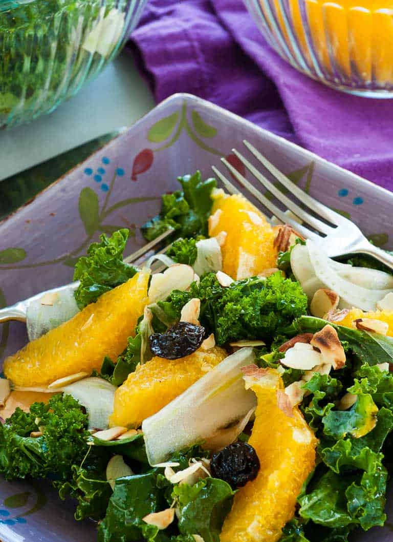 This flavorful salad is made with curly kale, raw fennel slices, sectioned orange slices, dried cherries, and slivered toasted almonds. All tossed with an orange juice, balsamic vinegar dressing.