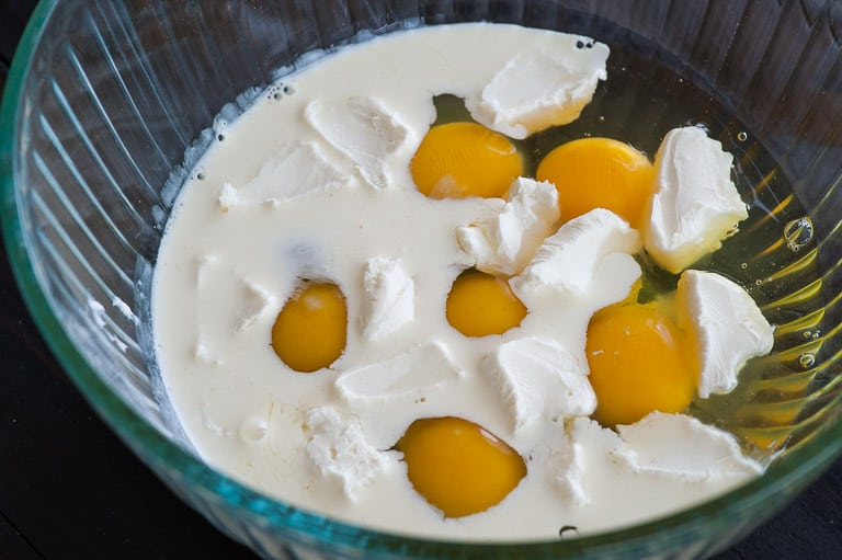 Eggs and cream ready to whisk. Scrambled eggs with smoked salmon. | joeshealthymeals.com