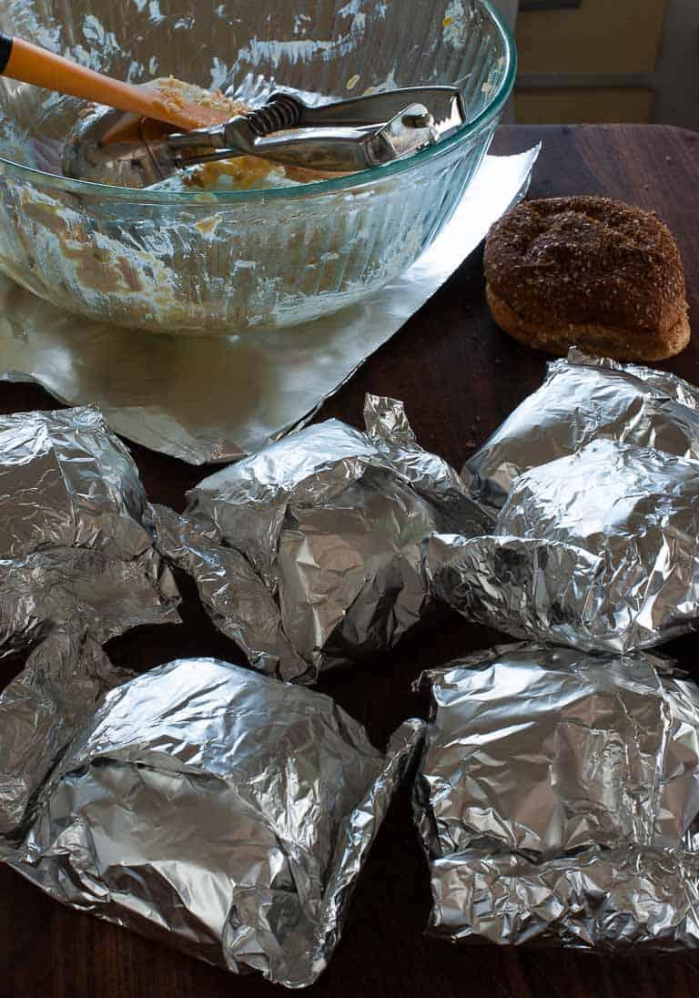 Tuna sandwiches wrapped in foil.